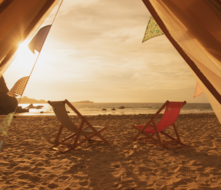 Sunset from glamping yurt at Lusty Glaze Beach, Cornwall.